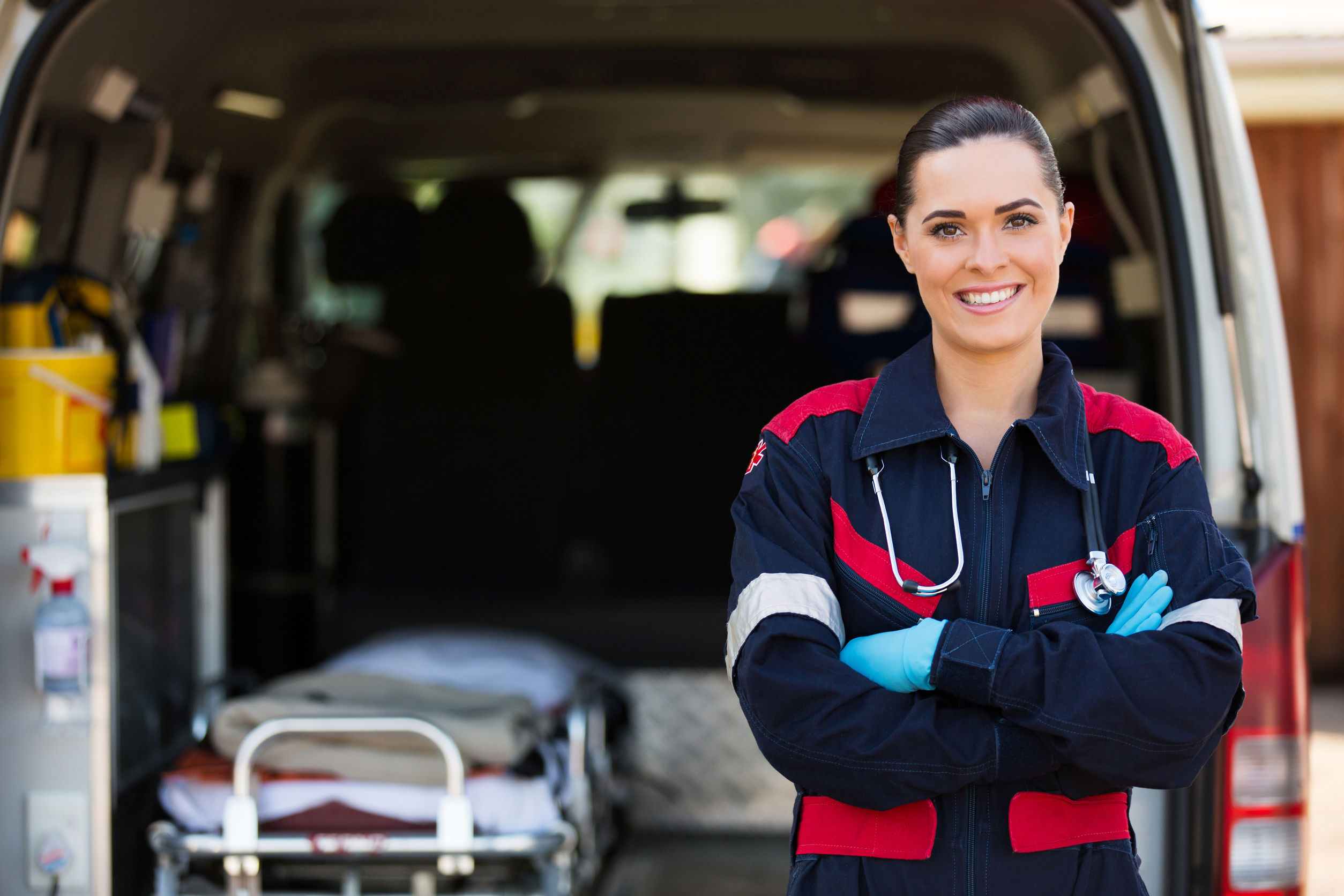 29514056 - attractive young female emergency medical service worker in front of ambulance